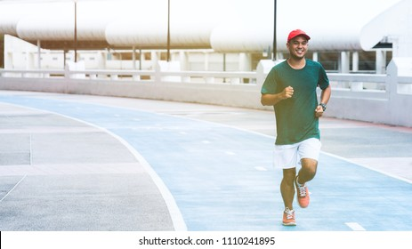 Young asian man running concept with copy space.
