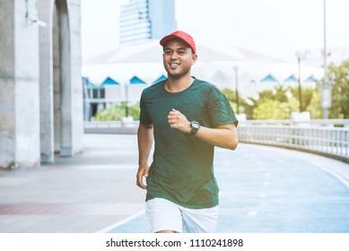 Young asian man running concept