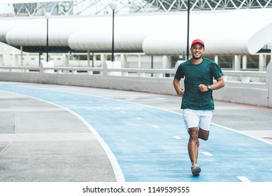 Young asian man running in the urban city with copy space. Fitness, workout, sport, lifestyle concept.