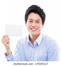 Young asian man showing empty card isolated on white background.