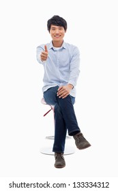 Young asian man showing thumb on the isolated on white background.