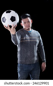 young asian man and soccer ball on dark background use for football mania
