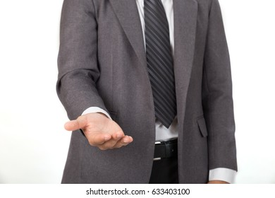 young asian man startup entrepreneur businessman in casual gray suit giving a hand, asking or offering help