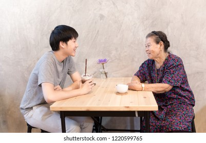 young asian man talk about his story with his mother, they  feeling  happy, family time in cafe, mother's day