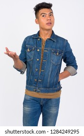 Young Asian man talking and gesturing against white background