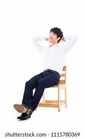 Young Asian man thinking on the chair isolated on white backgroung.