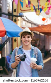 Young asian man traveler shopping walking on street market