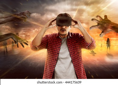 Young asian man wear VR headset get into virtual reality world