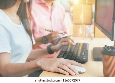 young Asian man and woman at office of their business online shopping.In home office