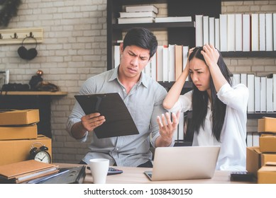 Young Asian man and woman  stress with her business online shopping at office.