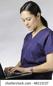 Young asian medical assistant using the computer.