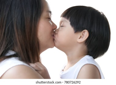 Young asian mother and her child kissing together on white background : Close up