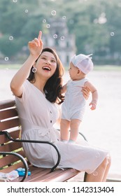 Young asian mother with her son
