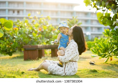 Young asian mother with her son in a vacation on a resort