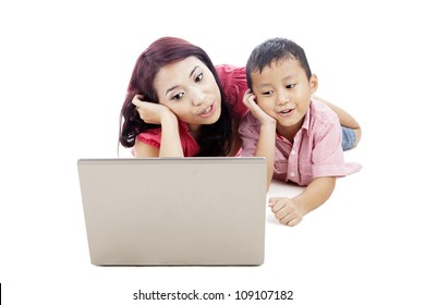 Young asian mother singing together with her son using laptop computer