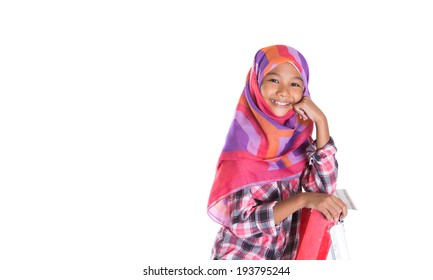Young Asian Muslim girl on a ladder over white background