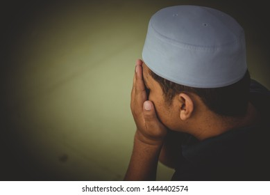 A Young asian muslim man praying on sunset,Ramadan festival concept