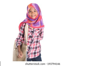 Young Asian Muslim school girl with headscarf and handbag over white background