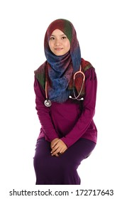 Young asian muslim woman doctor in head scarf