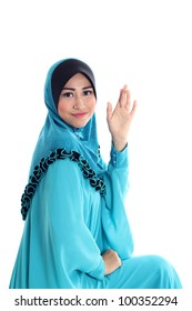 Young asian muslim women saying good bye and waving to you isolated on white