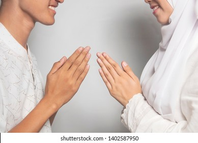 Young Asian Muslims greet each other on Eid Mubarak / Ied Fitr / Eid Al-Fitr celebration