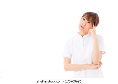 young asian nurse thinking on white background