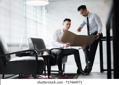 Young Asian office workers at work.