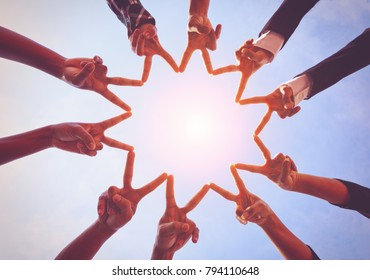 Young asian people putting their hands together,teamwork with stack of them hands showing unity,join hands partnership,teamwork concept.