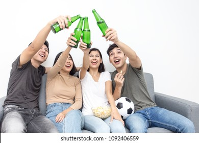 Young asian people watching television together. People wacth world cup soccer with happy emotion. People with lifestyle, entertainment, happiness concept.
