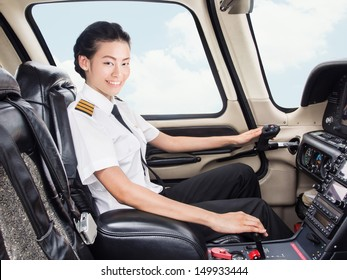 Young Asian pilot student in her uniform flying light craft plane in the sky