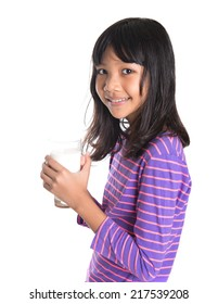 Young Asian preteen girl with a glass of milk over white background
