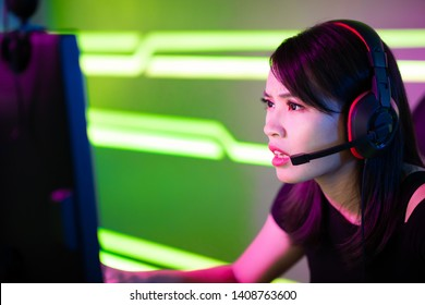 Young Asian Pretty Pro Gamer Playing in Online Video Game