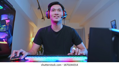Young Asian Pro Gamer have live stream with fans happily at home