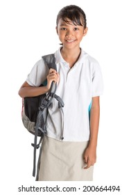 Young Asian school girl in school uniform with backpack over white background