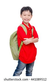 Young Asian schoolboy with backpack over white