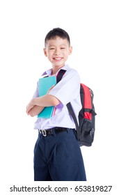 Young asian schoolboy smiling over white background