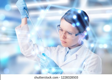 Young Asian scientist with test tube making research in clinical laboratory.Science, chemistry, technology, biology and people concept
