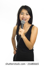 Young asian singing with microphone