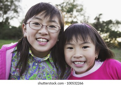 Young Asian sisters in the countryside