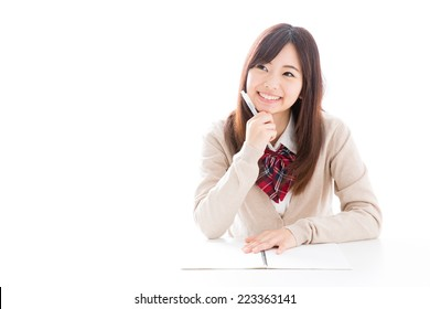 young asian student studying on white background