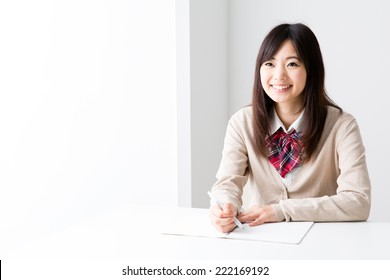 young asian student studying in the white room