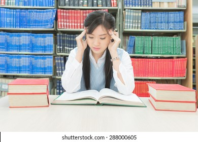 Young asian student under mental pressure