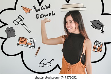 Young asian Student woman holding book with law school doodles