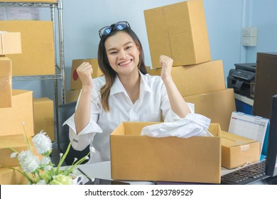 Young asian teenager owner business work at home for online shopping, checking order and prepaing package the product with office equipment, entrepreneur and alpha generation life style concept