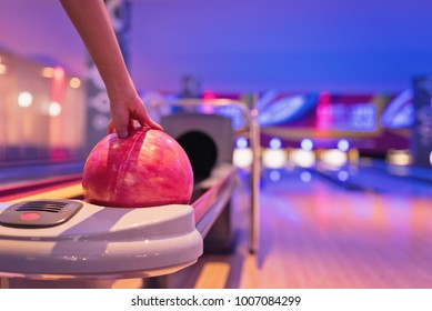 Young asian teennager holding bowling ball, bowling shoes and ball for bowling game, relaxing concept.