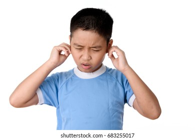 Young asian Thai boy has pain on ears, isolated on white background.