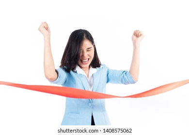 Young Asian Thai woman happy when reach a finish red ribbon line. Competition and success concept.