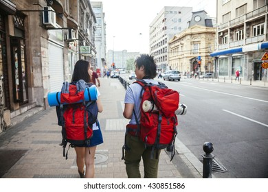 Young Asian Tourists Sightseeing