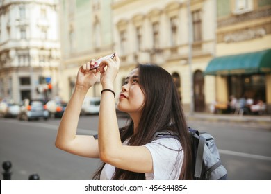 Young Asian Tourists Taking A Photo