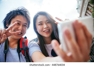 Young Asian Tourists Taking A Selfie